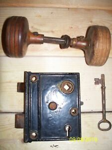Vintage Surface Lock With Deadbolt Key And Wooden Doorknobs