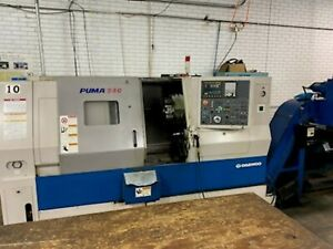 Used Daewoo Puma 240 c Cnc Turning Center Lathe 3 Bore Doosan Tailstock 2004