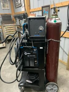 Miller Xmt 350 Multiprocess Welder With Cart And Wirefeeder