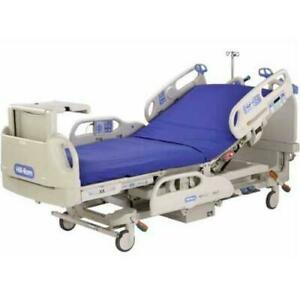 Hill rom Versacare Full Electric Hospital Bed With Bed side Table used