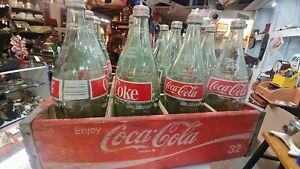 12 x 32 oz coca-cola money back bottles in case all have tops still in place