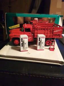 New in box. 1957 Coca Cola Diecast Stake Truck with dolly & 2 Coke Machines