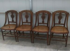 Set Of 4 Antique Victorian Eastlake Carved Walnut Cane Dining Chairs