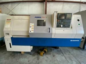 Used 2004 Doosan Daewoo Puma 240 lc Cnc Turning Center Lathe Fanuc Tailstock 10