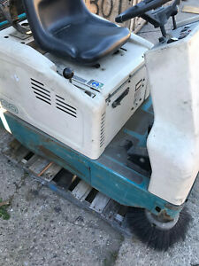 see Video Tennant 6100 Sub compact Battery Ride on Floor Sweeper
