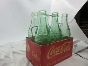 ANTIQUE COCA COLA  CARDBOARD CARTON WITH WIRE HANDLE 6 GREEN BOTTLES 25 CENT