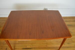 Excellent Danish Modern Teak Dining Table With Self Storing Extension Leaves