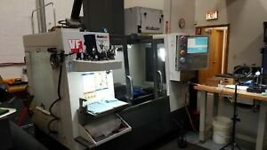 Used 2010 Haas Vf 2 Cnc Vertical Machining Center Mill W 10k Rpm Spindle 30x16