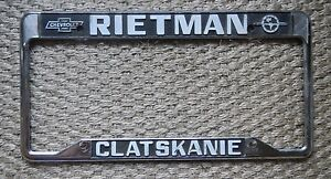 Rietman Clatskanie Chevrolet Dealership License Plate Frame Metal Embossed Rare