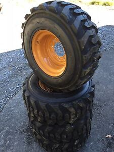 4 New 12 16 5 Deestone Skid Steer Tires Rims For Case 1845c 12x16 5