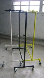 Urban Industrial Pipe Rack Yellow Rolling Garment Clothing Rack