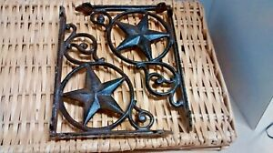 2 Cast Iron Shelf Brackets With A Large Star In A Circle