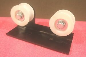 Forklift Two White Rollers spindles 3 X 1 1 2 inside With Bracket