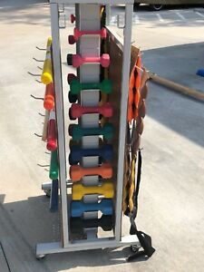 Physical Therapy Weight Rack Including Dumbells Cuff Weights Weighted Bars