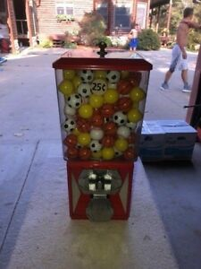 A a Global Po89 Vending Toy gumball Machine Used Filled With Sports Balls