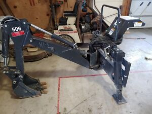 Slightly Used Swing Arm Bobcat Backhoe Attachment 506 Skid Steer