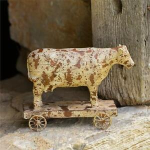 Vintage Look Rustic Small Carved Cow On Wagon Wheeled Base Pull Toy Primitive