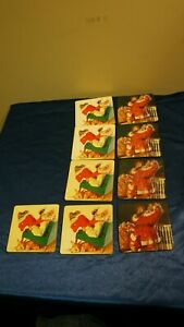 9  COCA COLA COASTERS 2000 SANTA IN CHAIR W DEER 1999 SANTA W TOY BAG (SET OF 2)