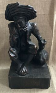 Hand Carved Wooden Figure Of Sitting Man In Hat With Sack Vintage