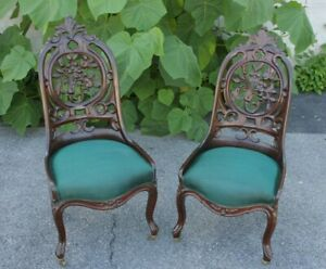 Pair Of 19th Century Belter Carved Walnut Chairs With Green Upholstery