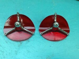 Two 1957 Oldsmobile Super 88 98 Tail Light Chrome Rocket Inserts And Red Lenses