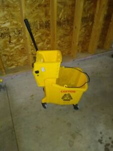 1 Rubbermaid Yellow Mop Bucket With Wringer Nice Used Condition