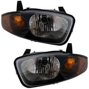 Headlights Set Fits 2003 2005 Chevrolet Cavalier Pair Headlamps Lens W Housing