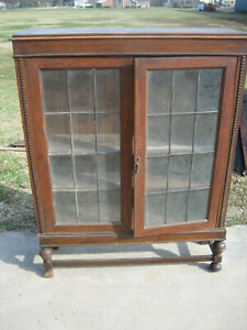 Antique Oak Display Cabinet With Leaded Glass Doors