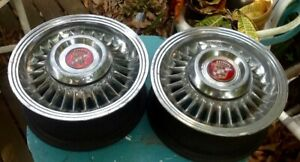 Two 1955 Cadillac Kelsey Hayes Sabre Wheels With Center Hubcaps And Medallions