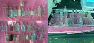 Collection Of 65 Antique Bottles Including Amber And Amethyst Colors