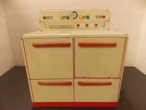 tin toy stove cooker well