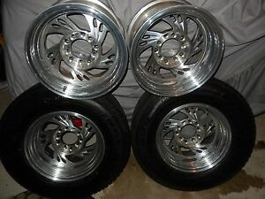 4 Polished Aluminum 15 Inch Wheels Rims 2 Firestone Fire Hawk Radial Tires