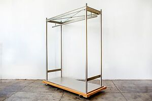 Unique Nickel Plated Steel And Glass Clothes Rack On Wood Base