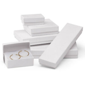 White Embossed Cotton filled Jewelry Box Assortment Case Of 75