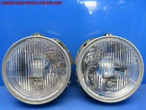 83 91 Porsche 944 Headlight Bulb Lamp W Bezels And Bracket Retainer Hella H4
