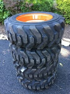 4 New 10 16 5 Skid Steer Tires wheels rims Camso Xtrawall For Bobcat