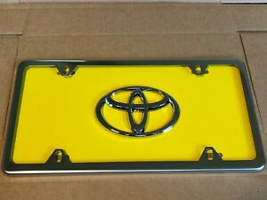 Yellow Toyota Front License Plate Tag With Silver Frame And Bolts