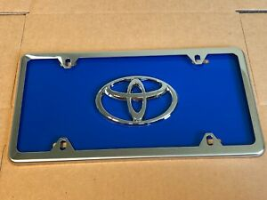 Blue Toyota Front License Plate Tag With Silver Frame And Bolts
