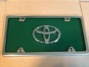 Green Toyota Front License Plate Tag With Silver Frame And Bolts