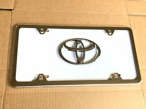 White Toyota Front License Plate Tag With Silver Frame And Bolts