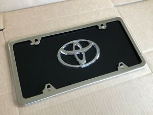 Black Toyota Front License Plate Tag With Silver Frame And Bolts