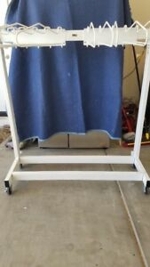 Garment Style Mobile 10 Arm Apron Rack From Wolf Used discounted