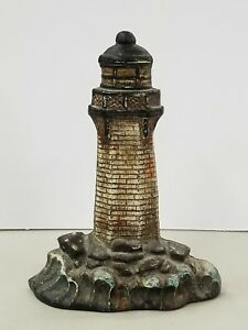 Rare Antique Cast Iron Figural Light House Doorstop With Waves Crashing On Rocks