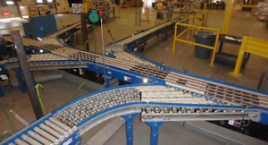 300 Foot Conveyor System Tgw Cruzbelt Powered Gravity Roller System Ermanco