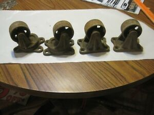 Set Of 4 Antique Cast Iron Caster Wheels 2 Swivel Well Made great Patina gwc