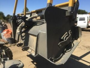 Loftness Timber Axe Masticaion Heads Skid Steer Attachment