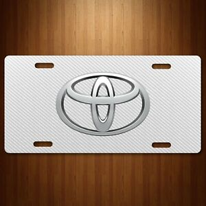 Toyota Aluminum License Plate Tag Simulated Carbon Fiber White New