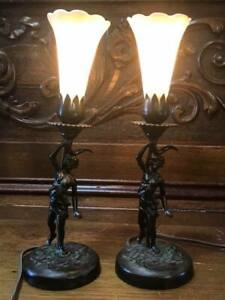 Pair Of Antique Bronze Cherub Lamps With Signed Steuben Shades