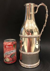 A Fine And Rare French Sterling Silver Wine Bottle Holder By Emile Hugo