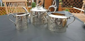 An Antique Silver Plated Tea Set With Respoused Patterns By James Deakin